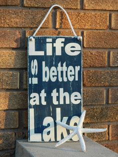 Life is better at the lake, wood sign- with nautical rope-lakehouse-cabin decor. $23.00, via Etsy.