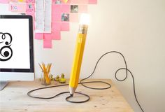 London design studio Michae & George's oversized pencil lamps add a fun touch to any room. They can be personalized and are also available in a mini self-standing version for your desk.