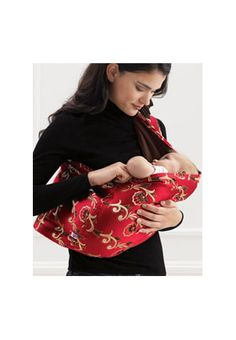 Baby Carrier   Baby Sling.  Ming Dynasty Hotsling Baby Carrier. Very compact and easy to use baby sling.    Wide shoulder that spreads evenly across your back.  Recommended for babies 8 pounds to 35 pounds. http://shrsl.com/?~38uo  $60