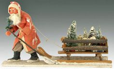 """Trodder"" Santa Claus pulling twig sleigh filled with bottle brush trees, German, circa 1920"