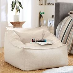 A cozy spot to sink in and prop yourself for movies, games or afternoon lounging, our Modern Lounger is covered in saddle-style upholstery that creates the look and feel of well-worn leather. In a cool cube-inspired shape, it's a modern take on ou… Cool Cube, Teen Lounge, Kids Lounge Chair, Pottery Barn Kids Backpack, Round Chair, Pottery Barn Teen, Lounge Seating, Sit Back And Relax, Modern Chairs
