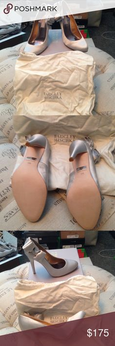 Brand New Badgley Mischka silver bow heels size 7 Brand New in box Badgley Mischka silver bow heels size 7. Comes with dust bag and original box. Badgley Mischka Shoes Heels