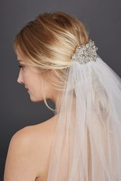 Complement your look with this playful yet elegant Mid Length veil. Mid length veil features a beautiful filligree comb Imported