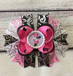A personal favorite from my Etsy shop https://www.etsy.com/listing/480145325/minnie-mouse-stacked-hair-bow-minnie