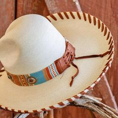 Palm Leaf Straw Hat with Turquoise Serape Hatband and German Silver Conchos. Features Hand Laced Deerskin Brim.  Determine Your Hat Size
