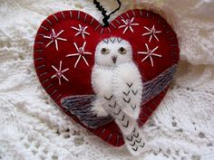 Snowy Owl poses majestically on a fallen log so you can see how handsome he is! I made this gorgeous ornament from 100% wool felt in a rich dark red