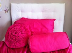 Pillows for the girls bed. Made out of sheets from Walmart. The flower one is just a long strip of fabric folder in half and sewn to the pillow in a spiral.