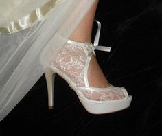 OMG I found my wedding shoes and i can get them in purple. the r different and so dang cute. just have to convince the fiance about the price. lol  Lace Bridal Wedding shoes 8473  with my gift by bosphorusshop, $175.00