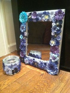 I painted this mirror grey then glued flowers on the frame. Then I glued the extra flowers on this glass jar.