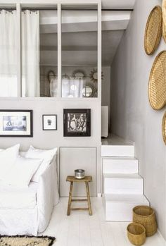 Stairs leading to the bedroom loft in a small French apartment