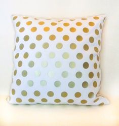 Gold metallic polka dot pattern on ivory cotton blend fabric. The gold metallic foil appliqué has a smooth satin finish. - choose your pillow size