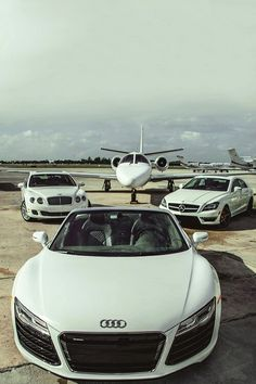 Audi R8, Bentley Continental, Mercedes CLS 63 AMG, and a private jet.