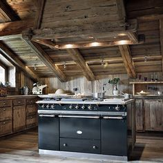 A stunning Chalet kitchen. I particularly like the colour of the wood used in this.
