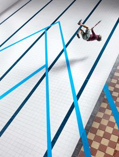 Game of Tennis In An Abandoned Swimming Pool Captured by Joseph Ford | Yellowtrace