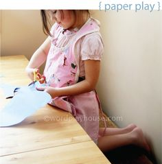 paper play: a practice in practical fine motor skills of using scissors and tape
