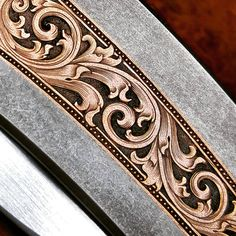 No automatic alt text available. Azulejos Art Nouveau, Filigree Tattoo, Arabesque, Custom Leather Belts, Leather Tooling Patterns, Mens Gold Bracelets, Tattoo Lettering Fonts, Metal Engraving, Leather Carving