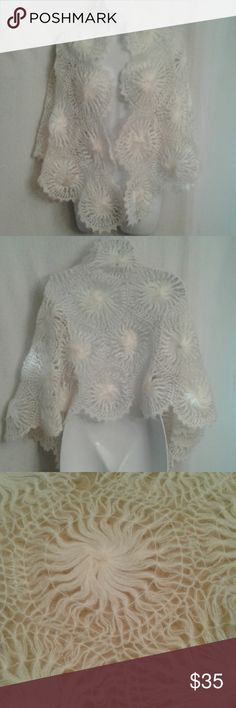 """Vintage cobweb knit bridal shawl This is a gorgeous, ethereal, cobweb knit, bridal shawl in EUC. It is a connecting pattern of hexagons with pinwheel centers and lacy, scalloped edges. Made in Japan of mohair and wool, it will really make a statement as the """"something old"""" portion of the bridal good luck keepsakes. As an heirloom, it can then be used to wrap your first born. It measures 60"""" wide and 24"""" long. Vintage Accessories Scarves & Wraps"""