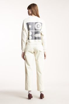 The Aerial Printed Sweat is a 100% cotton jersey sweater. A relaxed boxy cropped cut, with rib collar, cuffs and hem, with Kloke exotic matter print at rear. Al