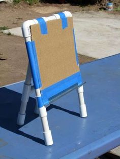 PVC Easel. Simple and portable. It also folds flat for easy storage! Just what I need for my classroom :)