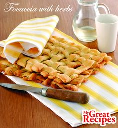 This is a truly impressive #bread a golden lattice of interwoven strips of dough flavored with spicy #oregano and #rosemary