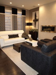 Drapery is often an overlooked item when it comes to decor and design. In reality it is one of the most important pieces for creating a polished look. It has the potential to accent, as well as tie in your color palette together all at once! We love using banding to accomplish this, as you can see the dark banding at the top of the panels brings in the color of the arm chairs and lamp shades, the white banding matches the sofa and area rug, as well as perfectly complimenting the roller…