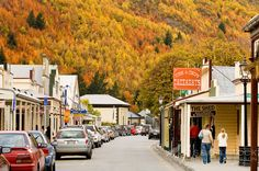 Looking down the main street of historic Arrowtown with Autumn trees covering the hills behind, Central Otago, South Island, New Zealand Arrowtown New Zealand, Queenstown New Zealand, New Zealand Adventure, New Zealand Travel, The Places Youll Go, Places To See, New Zealand Image, New Zealand Holidays, Hong Kong