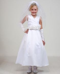 Marjorie: Satin Communion Dress with Ruffled Silk Flower SashMarjorie - White Flower Girl Dress This white satin dress is perfect for a communion ensemble. Although this dress is available in both a white or ivory base, the white dress matched beautifully with all of our communion and wedding accessories. This dress is fully lined with crinoline and can be customized in many ways.