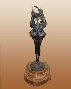 Chiparus Bronze Sculpture. Approx 18 inches tall. It sits on a Portoro Marble base.Includes certificate of authenticity.
