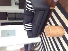 Ikea karlstad loveseat, crate and barrel rug, etsy tree stump, DIY throw pillows