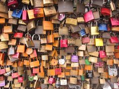 love locks on the Hohenzollernbrucke railway and pedestrian bridge in Cologne. Lovers etch their names on a lock, lock it to a fence and throw the key into the Rhine. So romantic!