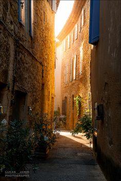 Golden light in tiny street in Lourmarin, Provence