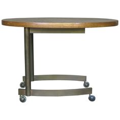 Side Table With Oval Top On Wheels