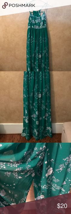 "Free People wide leg jumpsuit size 4 Lovely Free People wide leg jump suit. Sheer flowy fabric with lining shorts. Shade of Kelly green with floral gray and white accents. Great for a summer event. Size 4- 50"" length from top of front neckline to bottom hem. Good condition, but see photo for snag in the back, barely noticeable. Free People Other"