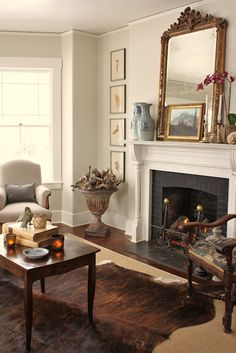 French mirror and blue & white Chinese jars on fireplace mantle. Framed botanicals. (Photo: for the love of a house)