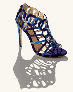 Alexandre Birman Suede/Python Ring Cage Sandal  Cast in inviting shades of cool blue, this Alexandre Birman sandal makes a stunning statement with interlocking rings of suede and python