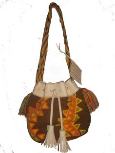 WAYUU FOR YOU . Mochilas with natural leather. Inner linning. Hand crafted in Colombia.  US $ 190.00