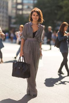 If you're petite and normally shy away from full-length jumpsuits, you might just need a waist belt to break up the line. Here, Miroslava Duma totally kills a black-and-white-checked one-piece. #refinery29 http://www.refinery29.com/58167#slide-3