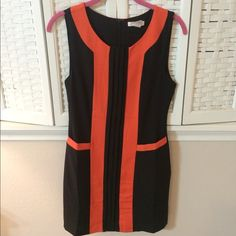 HPRetro Black and Orange Dress with pockets Adorable retro sleeveless black and orange dress with pockets, zips in the back. Worn once Esley Dresses