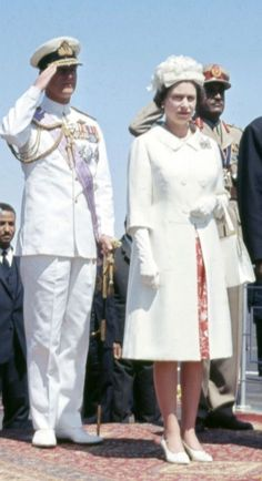 Queen Elizabeth II, wearing a white coat and matching pumps, watches a march after arriving at Khartoum Airport in Sudan in Young Queen Elizabeth, Elizabeth Philip, Princess Elizabeth, Princess Margaret, Hm The Queen, Her Majesty The Queen, Save The Queen, Queen Hat, King Queen