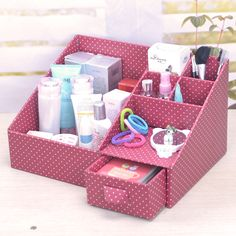 cardboard organizer, use contact paper of your choice.  I see the leather look contact paper over boxes pieced together to make this look high end!