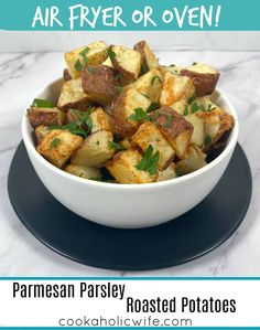 Parmesan Parsley Roasted Potatoes -the perfect, flavorful side dish to any meal. Make these potatoes in the oven or air fryer. #airfryerrecipes #roastedpotatoes