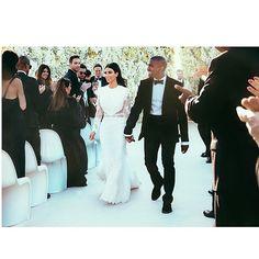 Kim And Kanye Seal Their 'I Do's' With A Kiss: See Kim's Wedding Pics