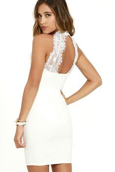 You'll be absolutely irresistible in the Endlessly Alluring White Lace Bodycon Dress! This sexy stretch knit dress has a high halter neckline and a fitted bodice (with princess seams) that sets above a figure flaunting skirt. Two panels of sheer lace accent the open back for an enticing finishing touch. Hidden back zipper.