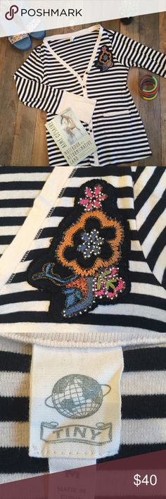 Anthropologie Art School Cardigan EUC Anthropologie Tiny brand black and cream striped cardigan, with colorful flower embellishment, size M. Fabulous wide cuffs and functional pockets on front. Looks super cute with jeans, over a casual t-shirt.   Book recommendations are always free. 📚😀 Anthropologie Sweaters Cardigans
