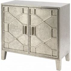 Lovely New Things Astor Two Door Cabinet £795.00 A metallic hand embossed two door metal cabinet with a removable shelf. Enchant your room with the stunning piece. Decorate it with some picture frames, candles or leave it as it is to speak for itself. With this piece, you won't have to think about being stylish. Pop into our showroom and see for yourself.