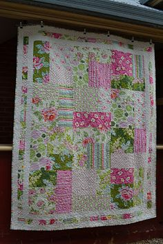 "Quilt details:  Fabric: Heather Bailey Nicey Jane (pinks), yellow homespun for the back  Pattern: I'm a Ginger Monkey with 2 1/2"" borders  Size: 76"" x 60"""