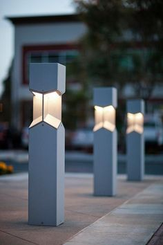 Knight Bollards shown in security bollard configuration with Silver Texture powdercoat at Pacific Office Plaza, Tustin, California bolardos con Luz Cool Lighting, Outdoor Lighting, Lighting Design, Lighting Ideas, Blitz Design, Plaza Design, Outdoor Floor Lamps, Luminaire Applique, Garden Lamps