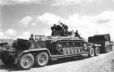 Photo one of a Afrika Korp Famo SdKfz 9 hauling a Panzer 3 tank on it's special heavy duty trailer