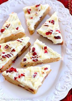 Cranberry Bliss Bars - a knockoff of the Starbuck's treat. A blondie dotted with white chocolate and cranberries with a slight hint of orange. the-girl-who-ate-everything.com