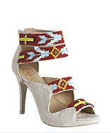 So pretty. I'm obsessed with native american flair in shoes. From Candela.